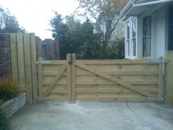 farm style wooden gates with anti climb timber backing